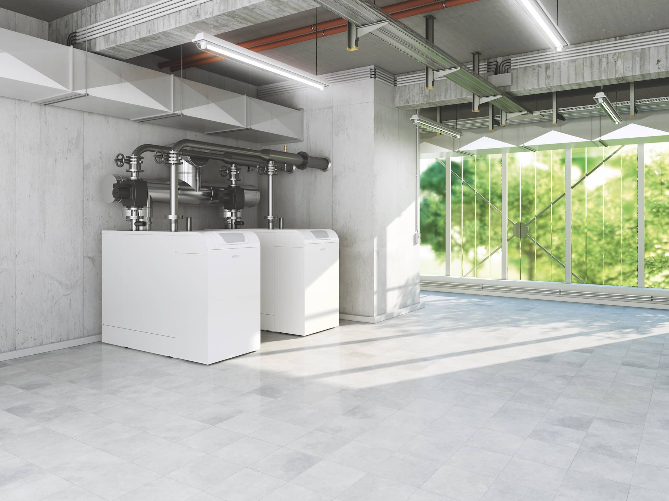 Der Gas-Brennwertkessel SGB von BRÖTJE steht in einem großzügigen, hellen Raum mit Fensterfront.