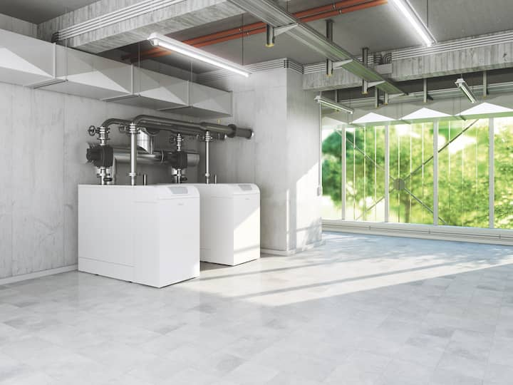 The BROETJE gas condensing boiler SGB is placed in a big, light room with windows.