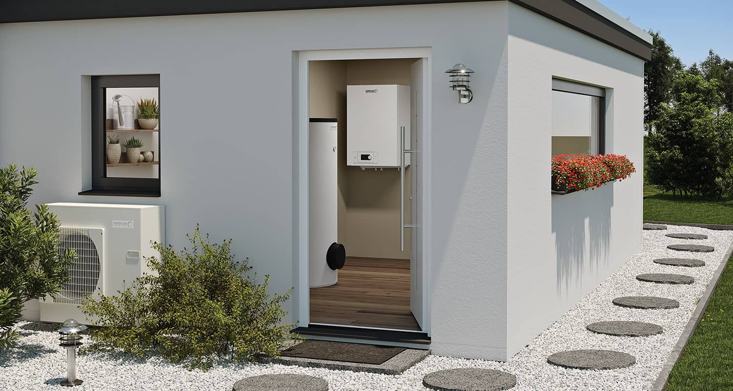Exterior view of a boiler hut in a garden overlooking a BLW Split internal heat pump.