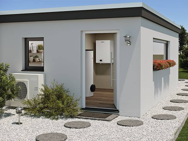 Exterior view of a boiler hut in a garden overlooking a BLW Split internal heat pump.