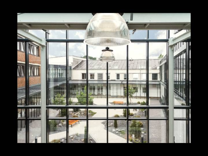 A view through a window to a courtyard on company premises.