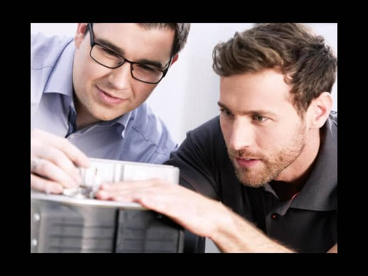 Two Brötje employees who are taking a closer look at a product.