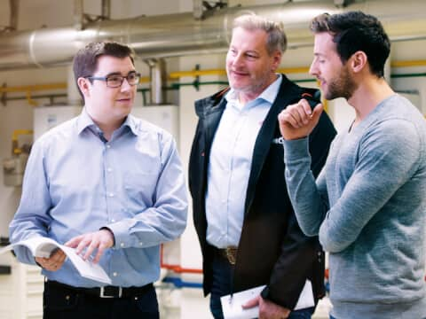 Two men receiving advice from a Brötje employee at the company.