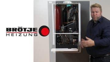 Bild für ein youtube Video der Gasheizungen. Im Bild ein Mann mit dunklem Hemd, einer Gasheizung und dem Brötje Logo.